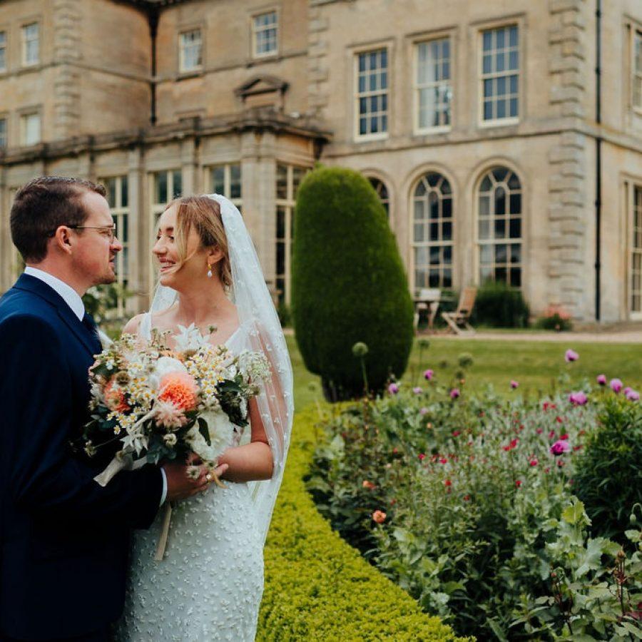Bride and groom peach wild flowers