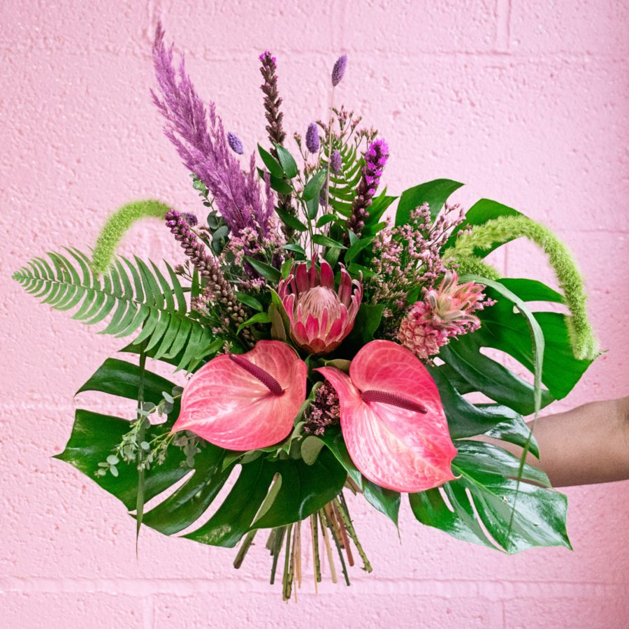 Exotic pink flowers with tropical leaves Valentine's Day flowers
