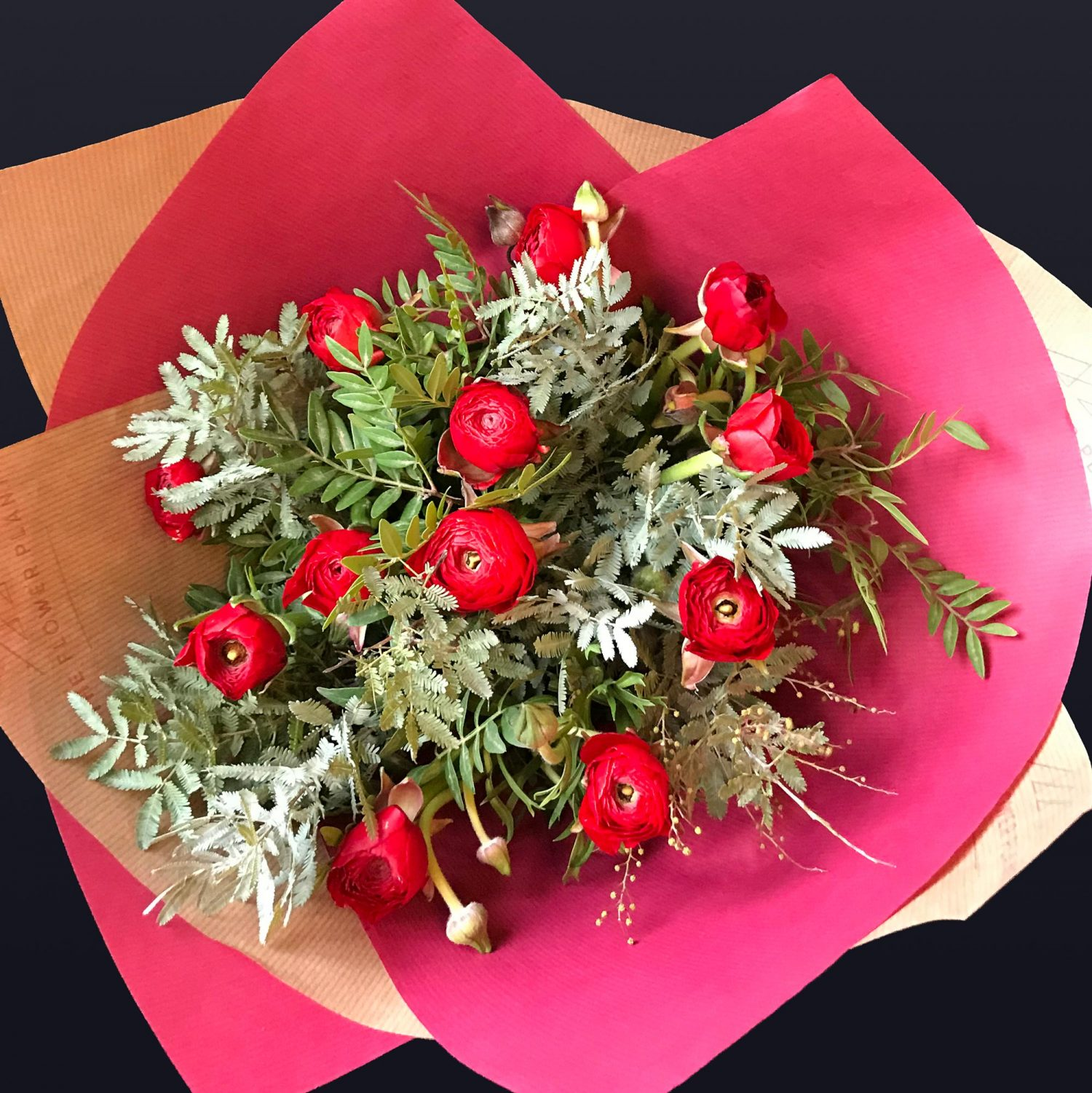 12 Red Ranunculus Hand Tied