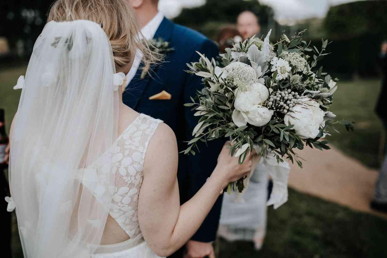 Bride just married white wild bouquet