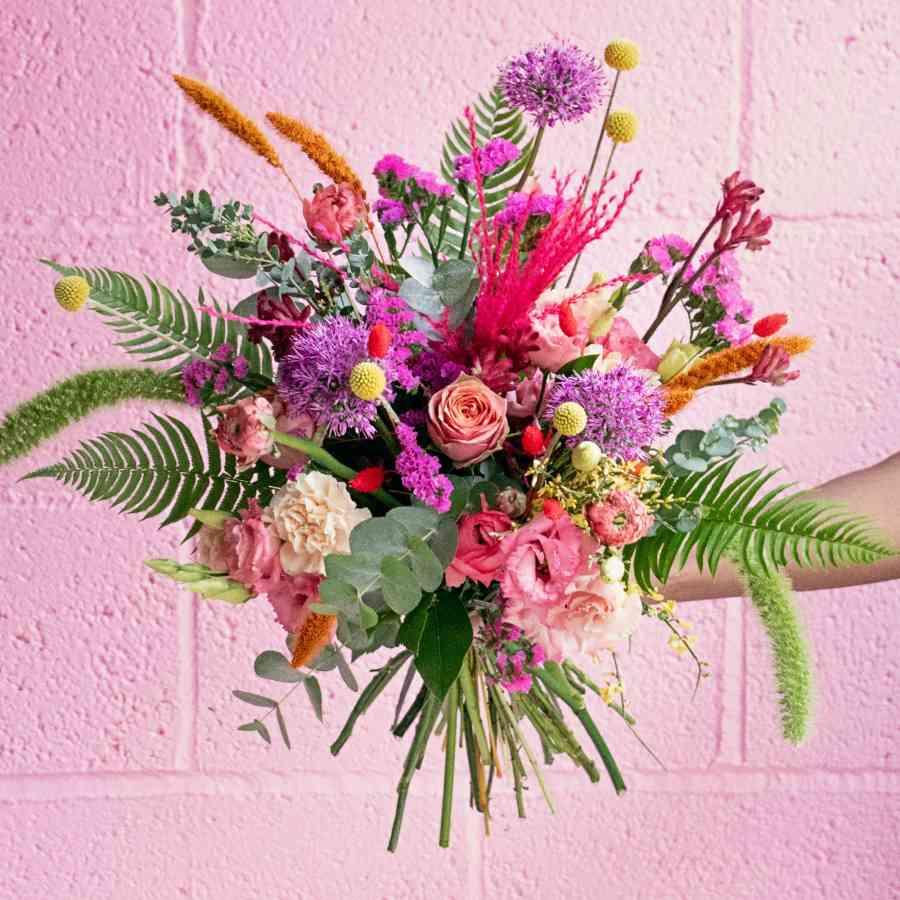 Wild purple, orange, yellow and pink Valentine's Day flowers
