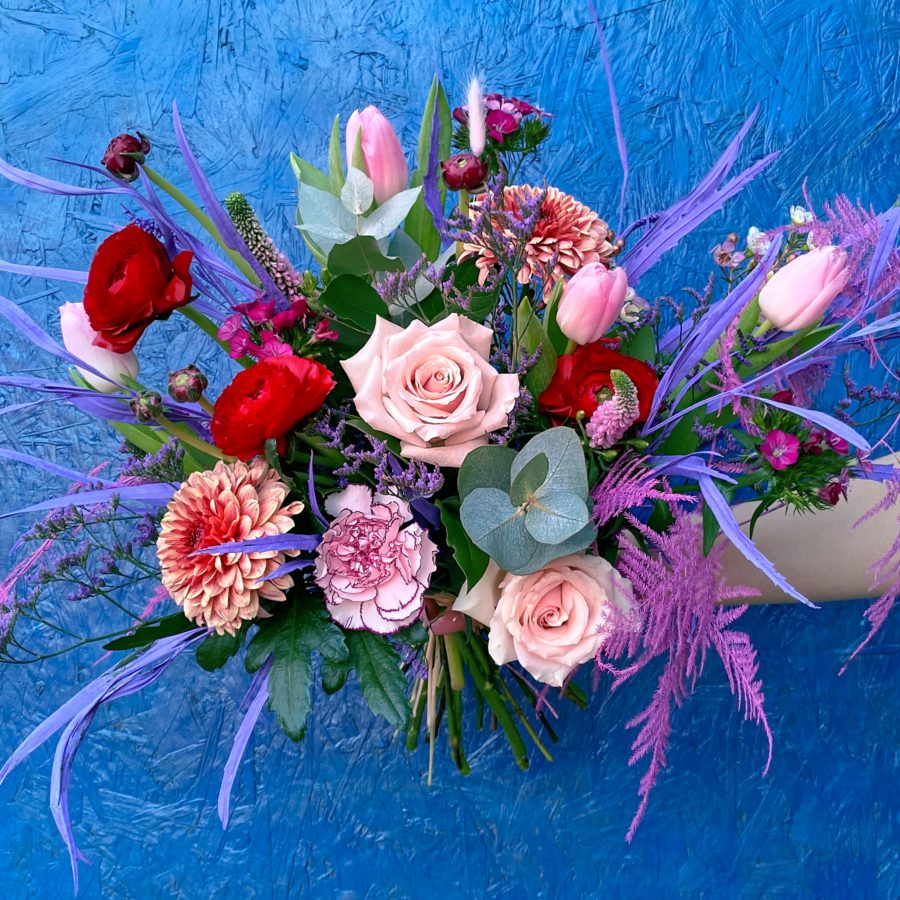 Pink, reds ranunculus, roses, tulips and eucalyptus - Valentine's flowers