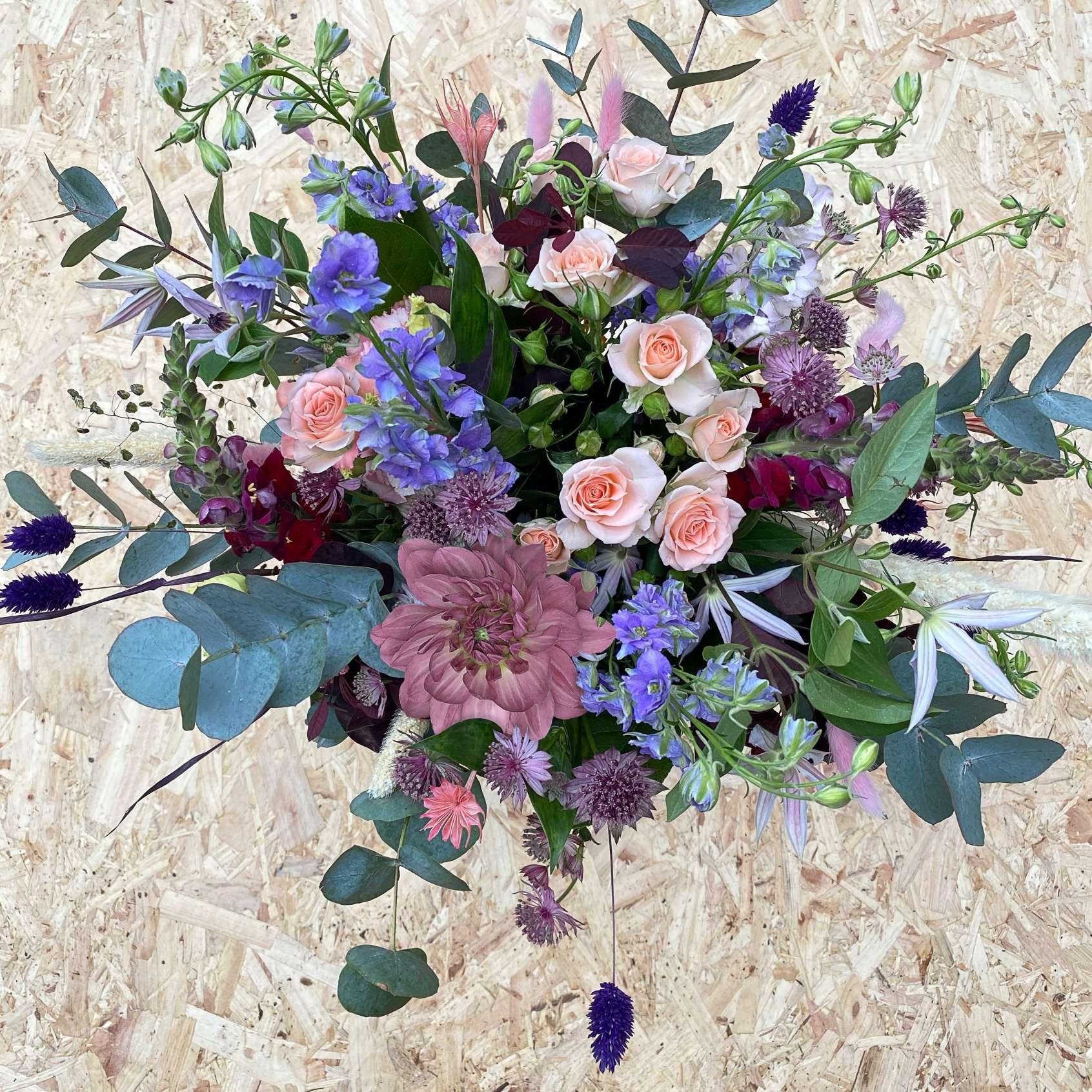 Pastel coloured hand-tied flower bouquet