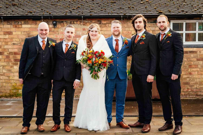 Bright Orange Wedding Bouquet And Buttonholes