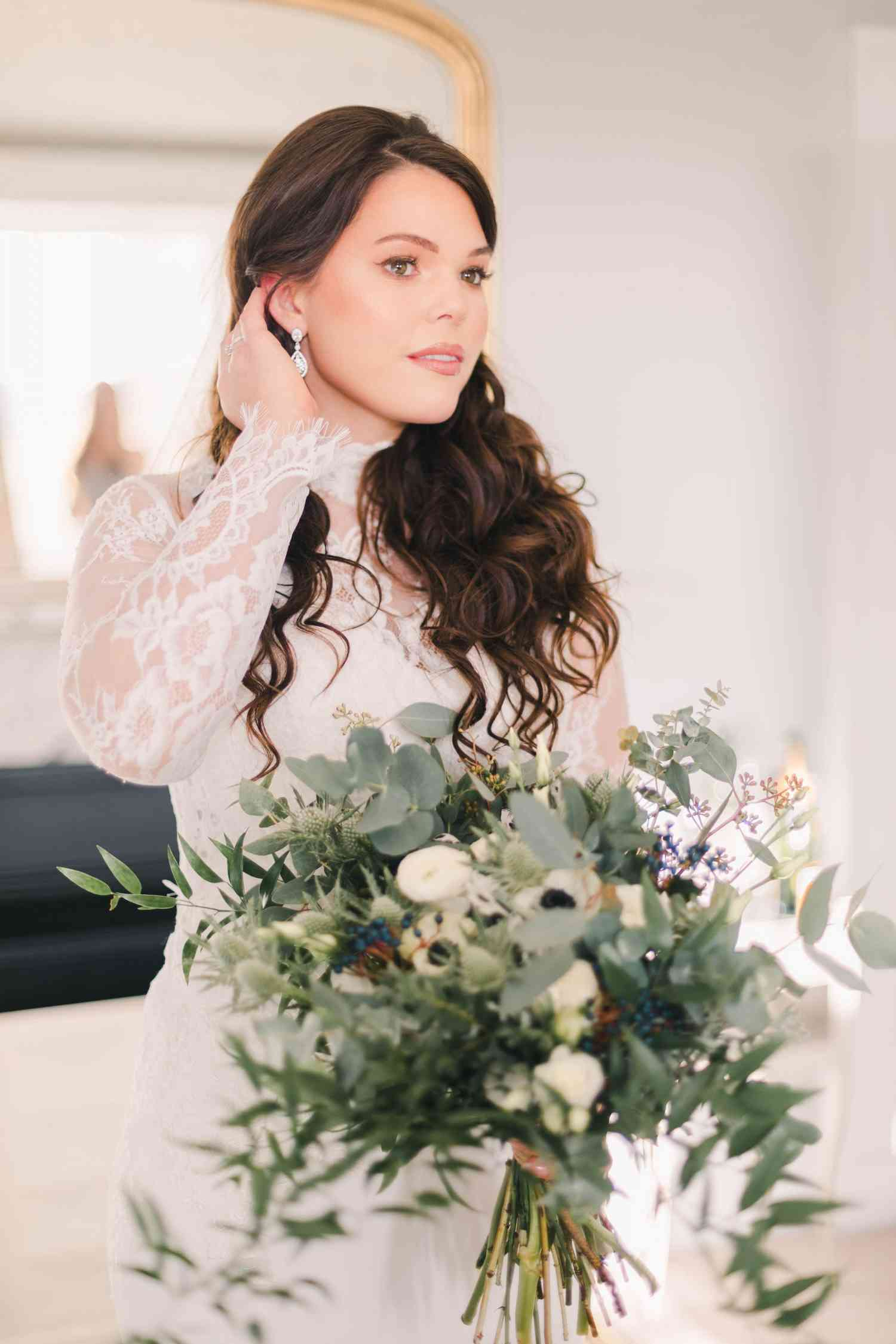 Bride holding wild whimsical bouquet